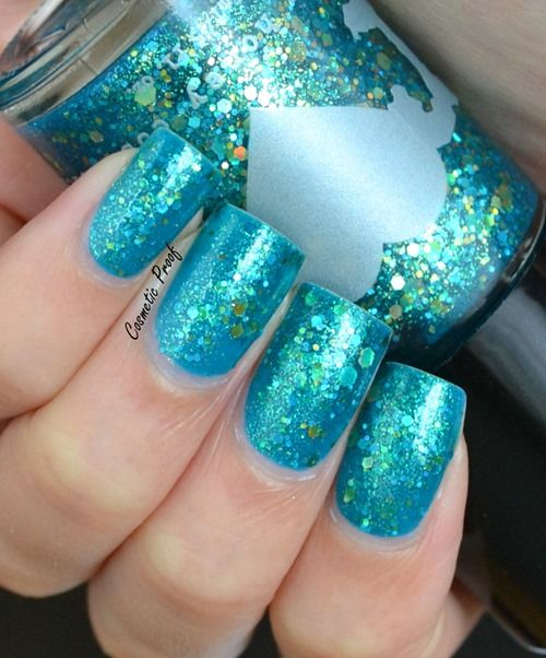 Teal nails with glitter