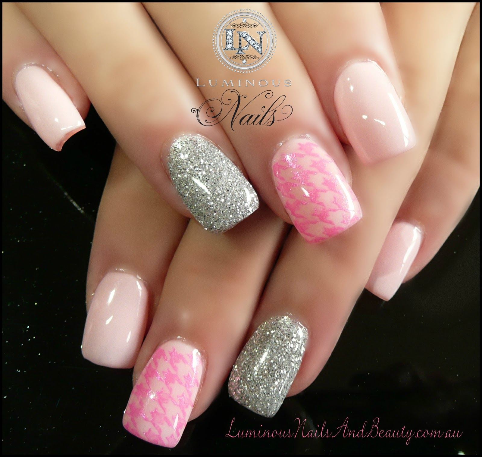 Pink and silver glittery nail design