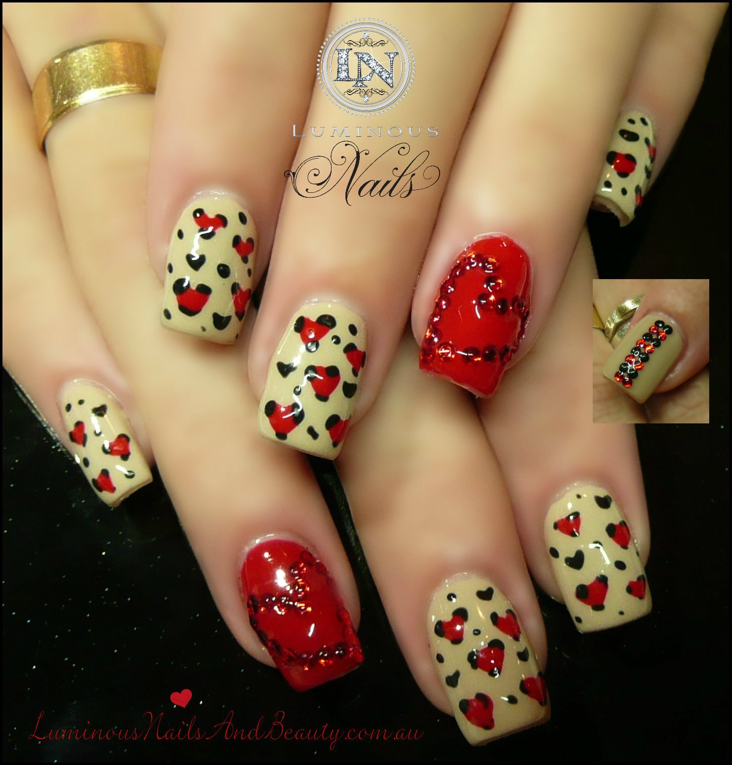 Red and nude heart nail design
