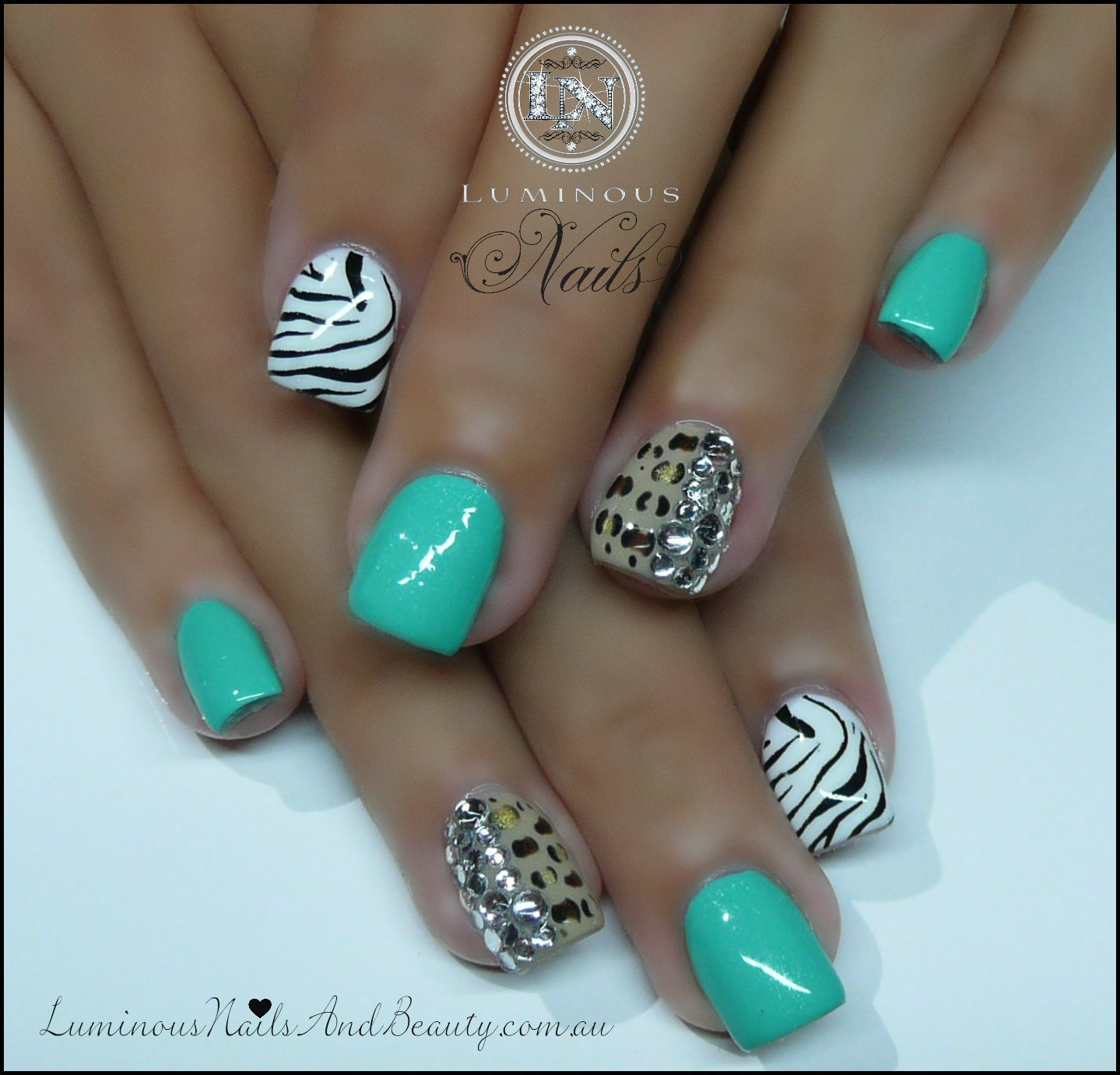 Mint nail design with crystals