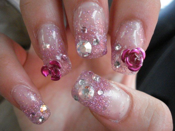 Glittering pink nail design with crystals