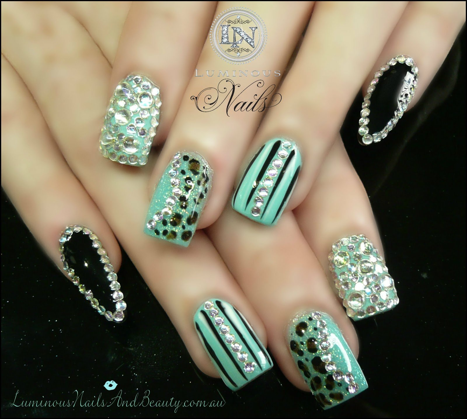 Black and mint decorated nail design