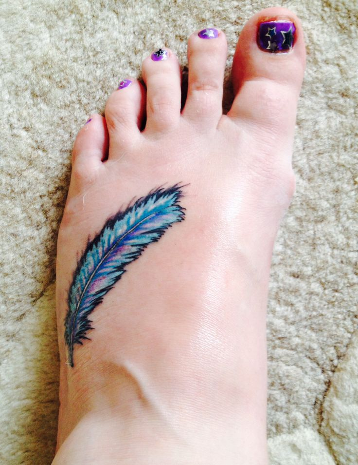 Blue feather tattoo