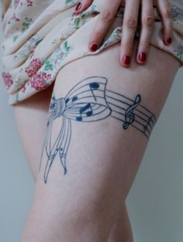 Music tattoo on the thigh