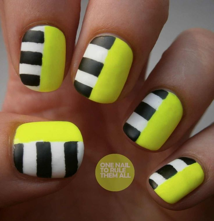 Yellow, black and white nails