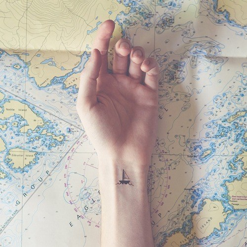 Beautiful sailboat tattoo on the wrist
