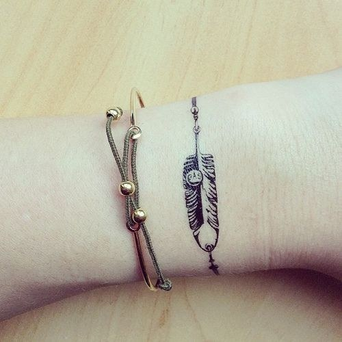 Feather bracelet tattoo
