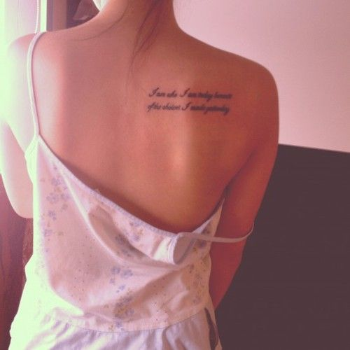Quote tattoos on shoulder blade
