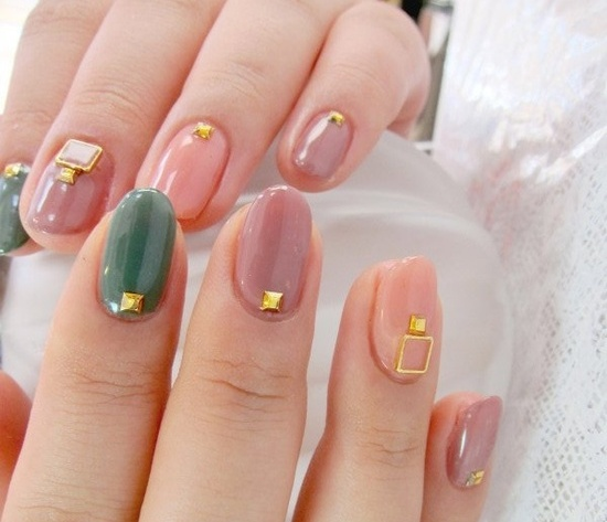 Peach and gold decorated nail art