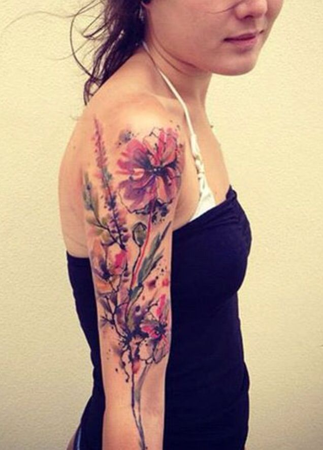 Arm watercolor tattoo