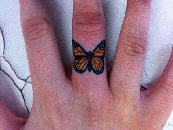 Beautiful butterfly tattoo on the finger
