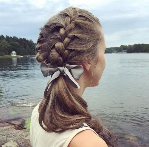 Braided ponytail with a bow
