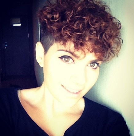 Chic shaved hairstyle with top curls