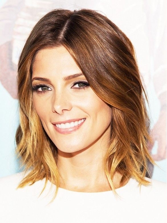 Medium length haircut with subtle waves at the ends
