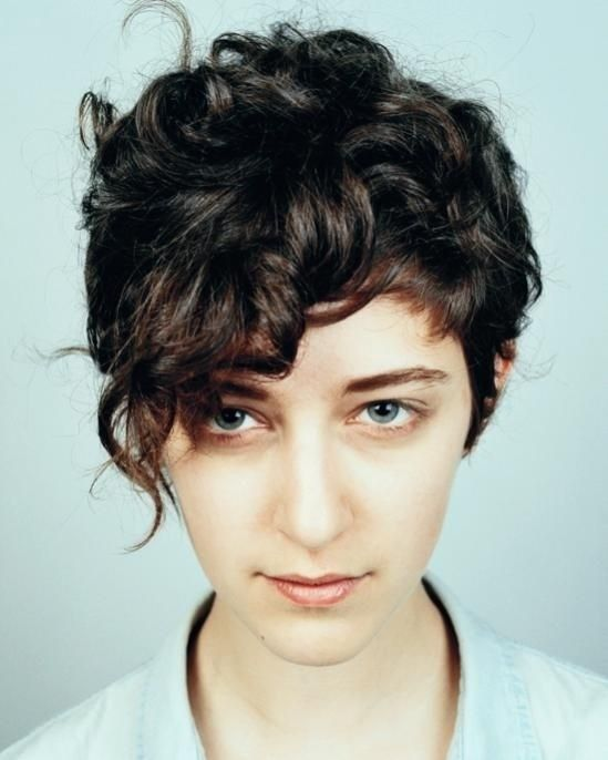 Curly pixie hairstyle with bangs