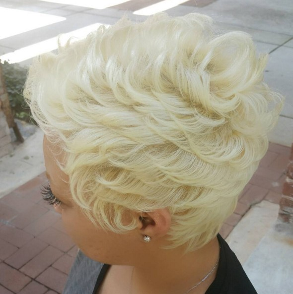 Blonde pixie haircut with curls
