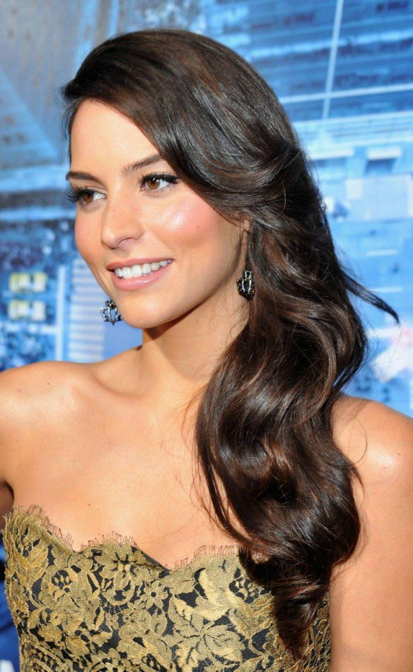 Genesis Rodriguez's long wavy brown hairstyle