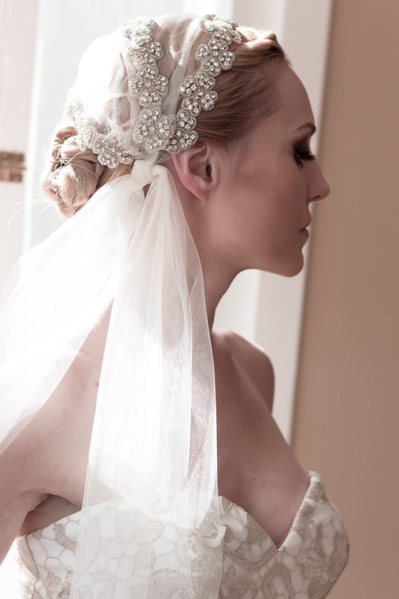 Bride updo hairstyle with veil and hair pieces