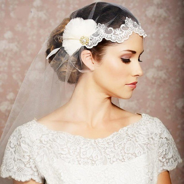 Wedding hairstyle with veil and hair pieces