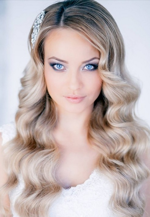Noble wedding hairstyle for long, wavy hair