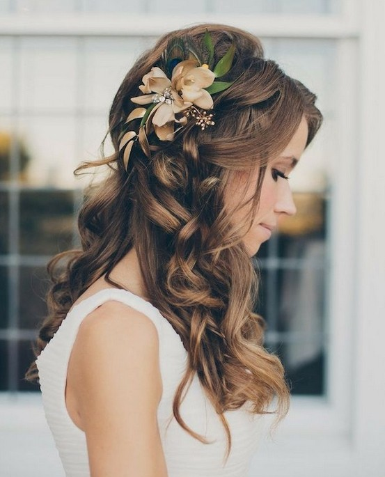 Glamorous half up half down hairstyle for the wedding