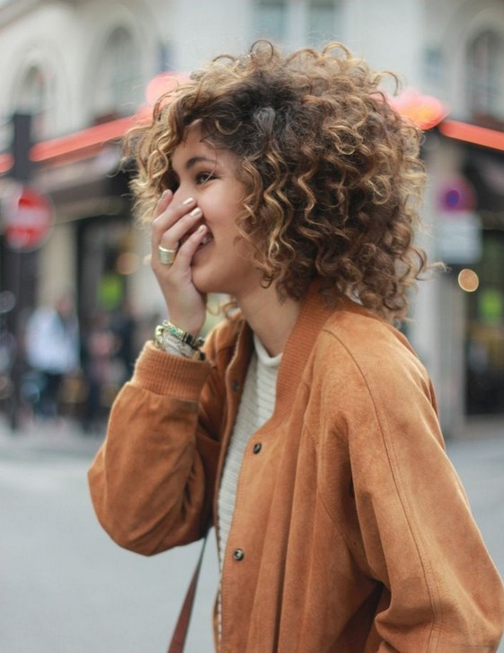 Highlighted curly hairstyle for short hair