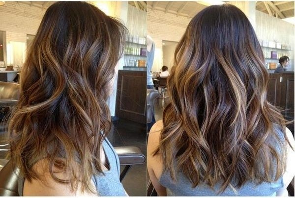 Long wavy hairstyle with blonde highlights