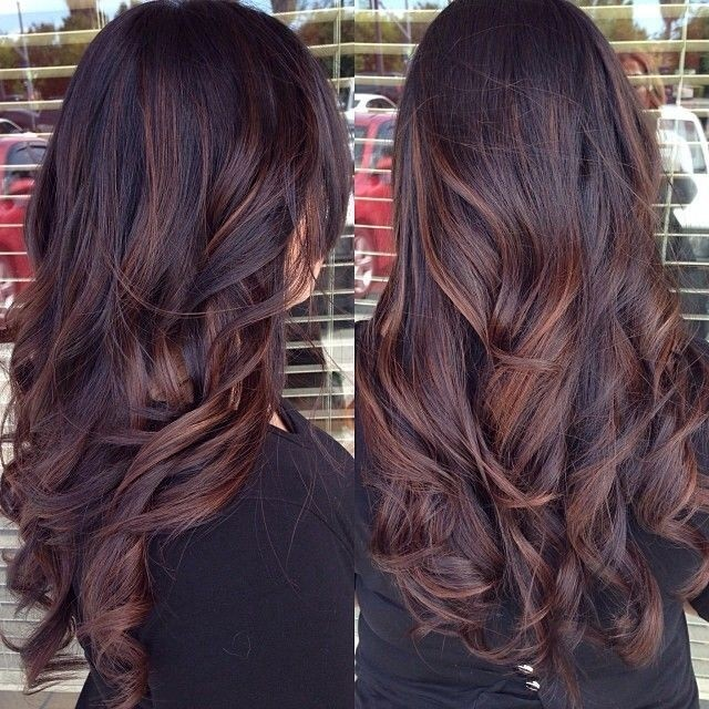 Long wavy hairstyle highlighted in red