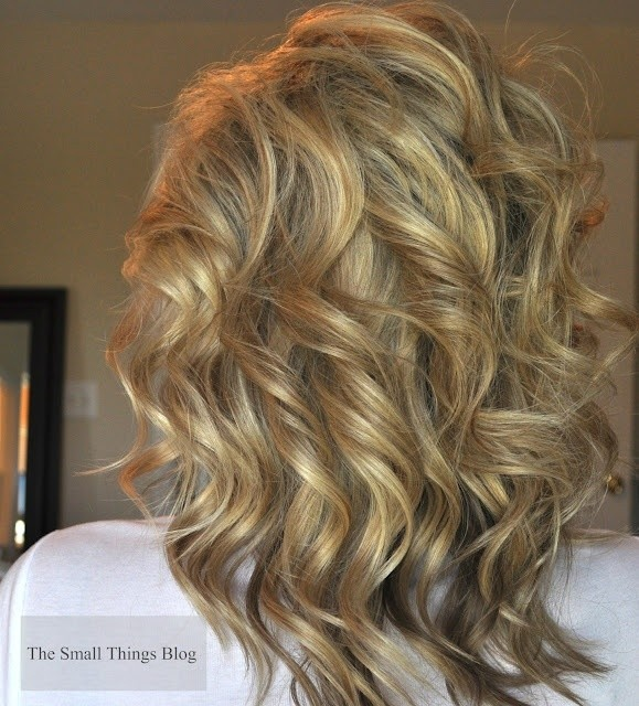 Medium layered curly hairstyle