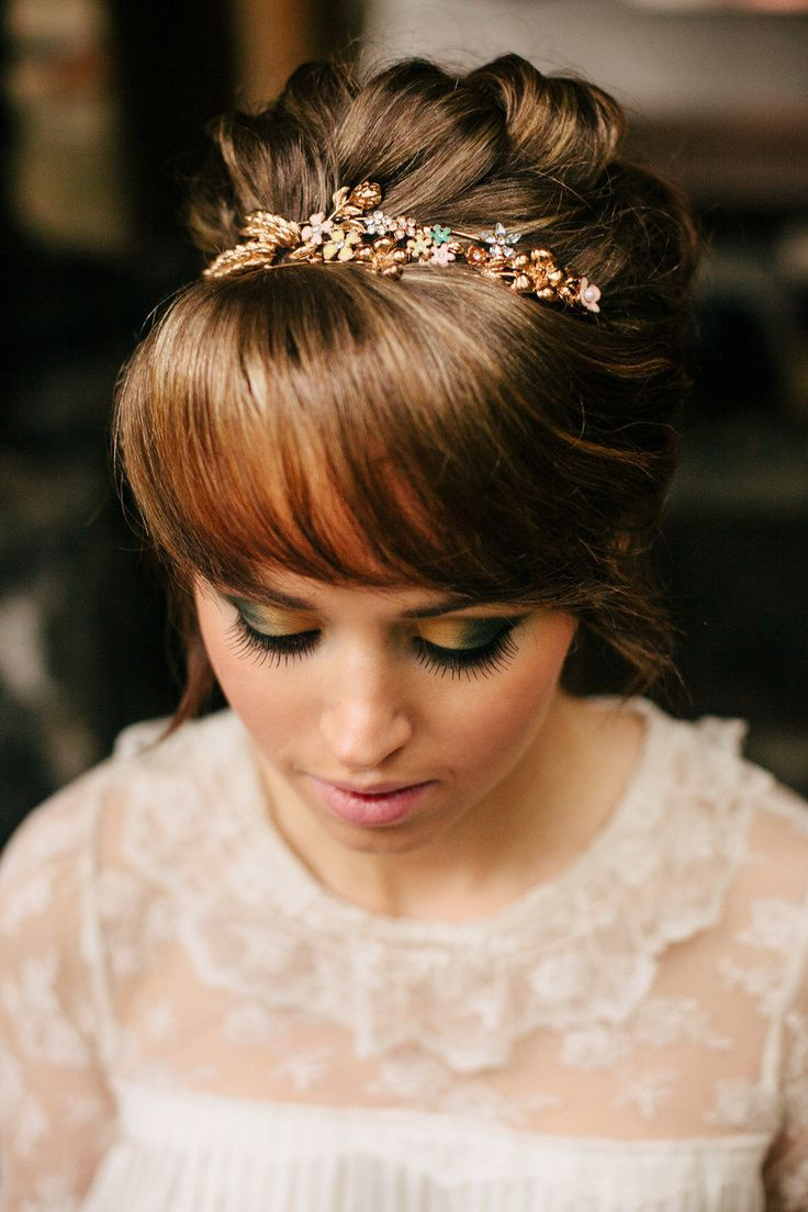 Updo hairstyle with wispy bangs