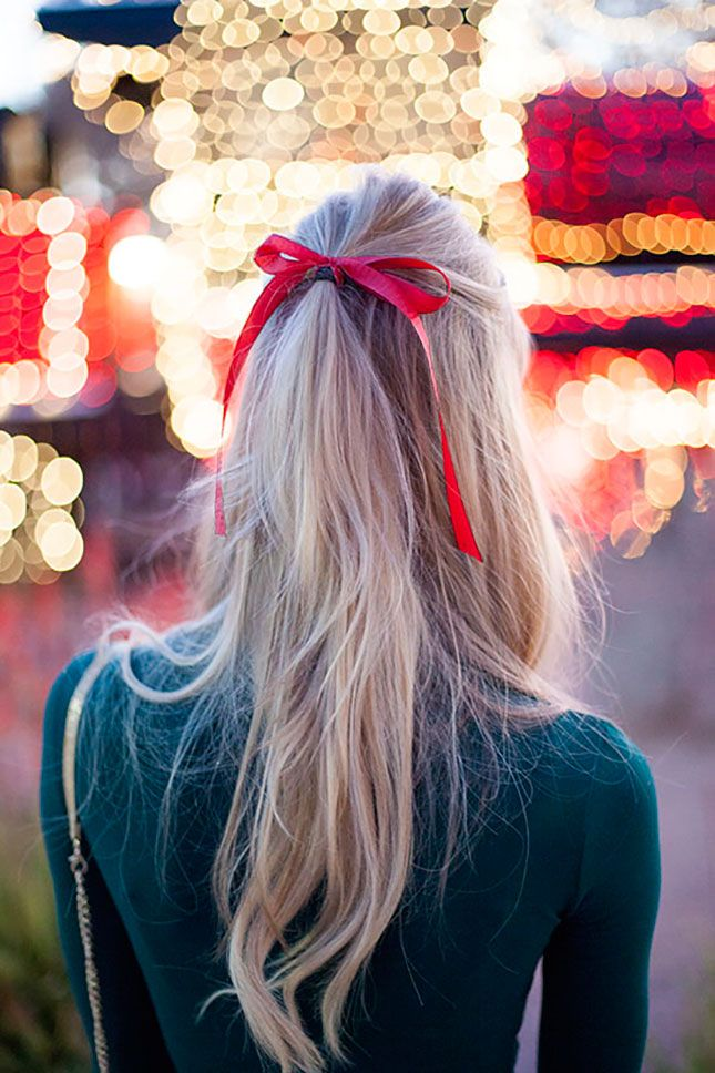 Blond hair with a red ribbon