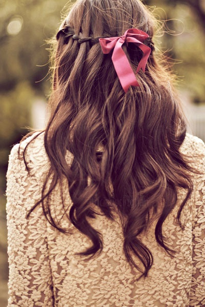 Waterfall hair with a pink ribbon