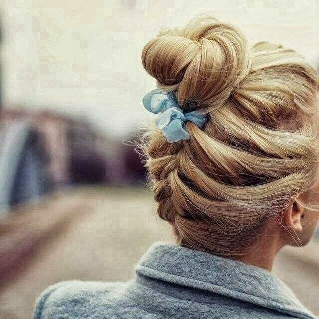 Braided bun with a blue ribbon
