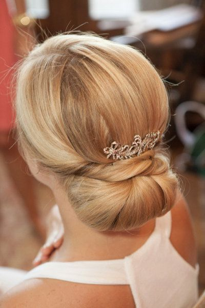 Voluminous lower updo with hair accessories