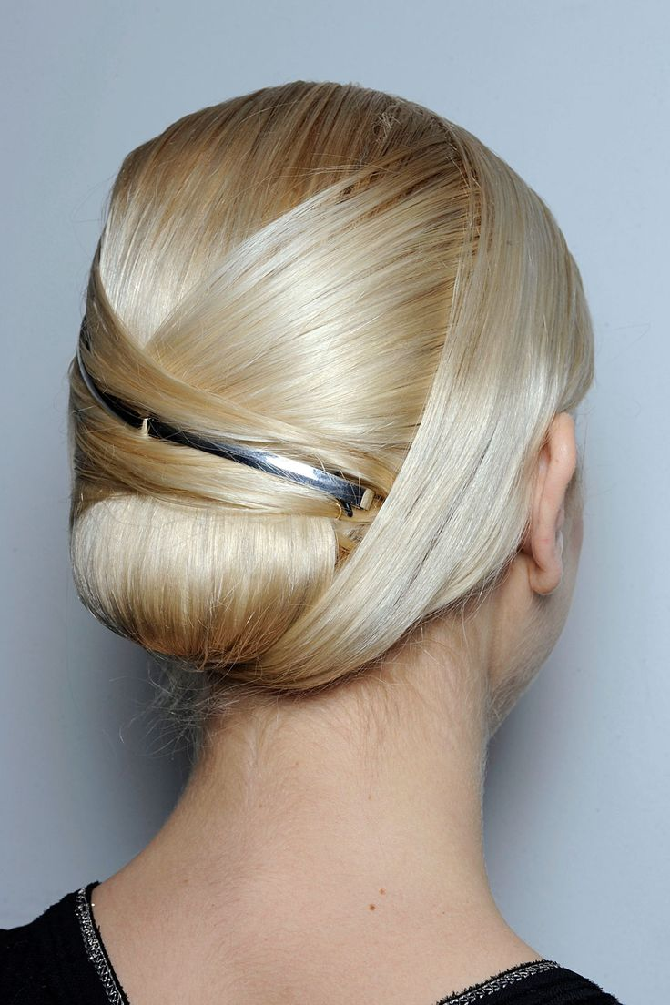 Slim updo with a metallic accessory