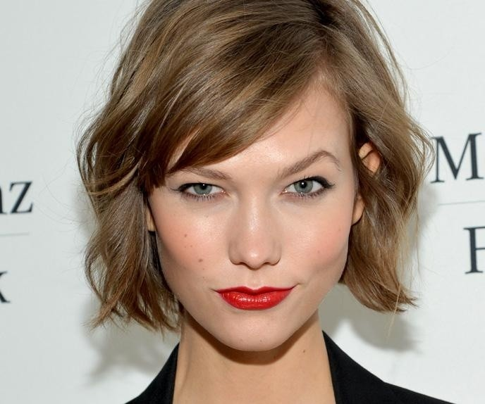 Loose waves with side bangs for long faces