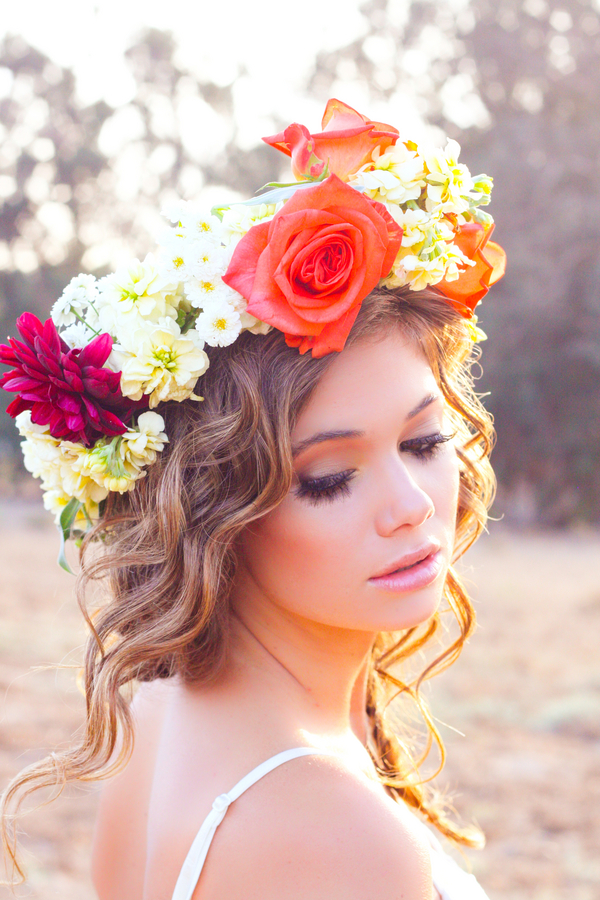 Romantic braided hairstyle with floral crown