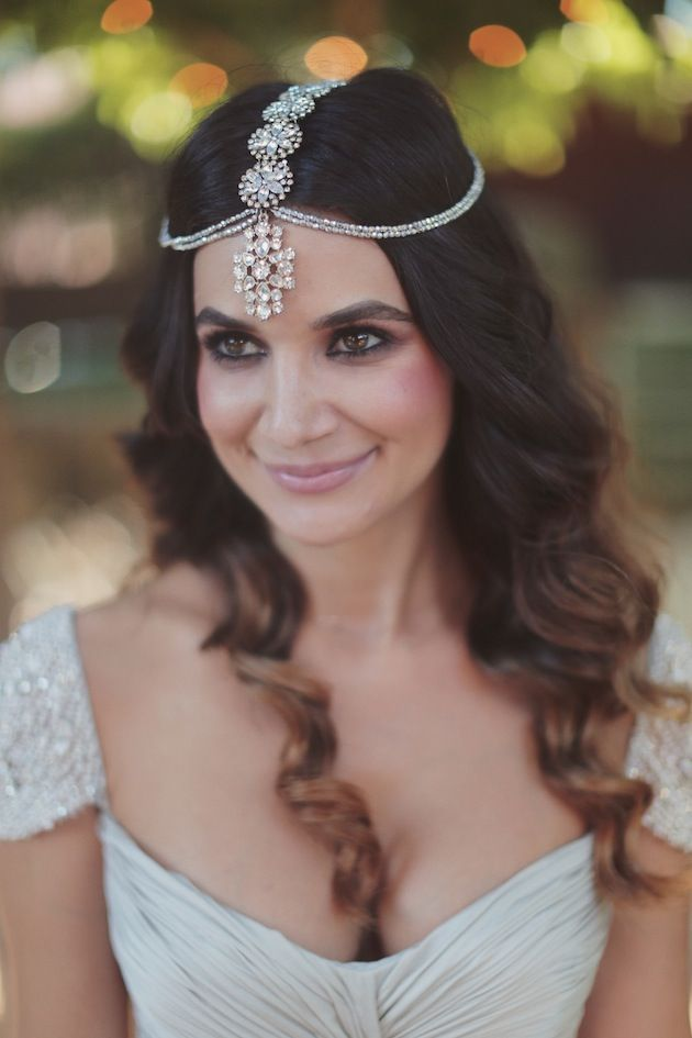 Gorgeous Indian wedding hairstyle with headgear