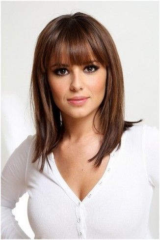 Medium length hairstyle with bangs and layers