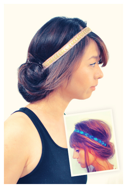 Rolled up hairstyle with a headband