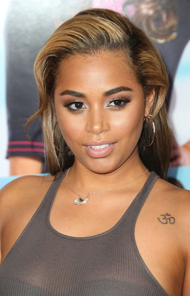 Lauren London teased her hair