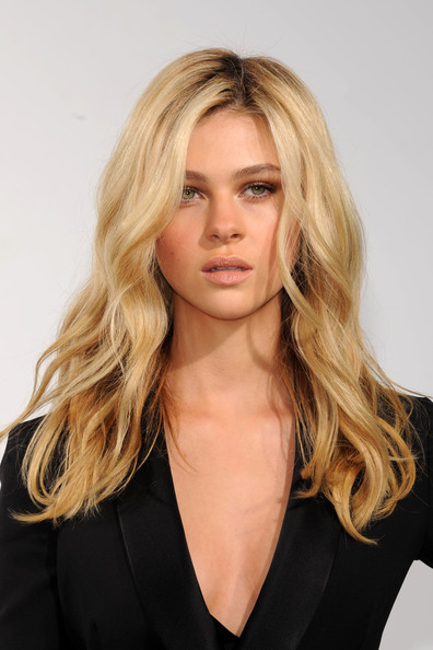 Nicola Peltz Lange tousled long wavy hairstyle and nude makeup