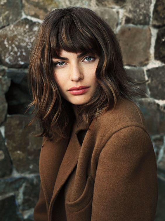 Caramel highlighted curly bob hairstyle