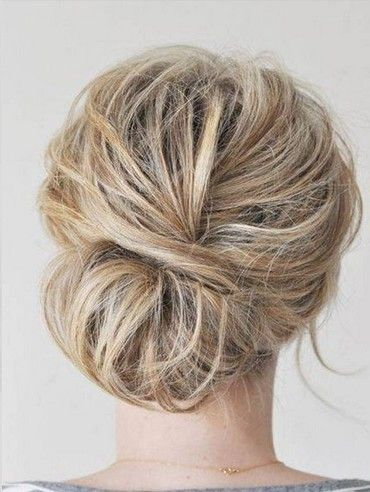 Chaotic bun hairstyle for medium hair