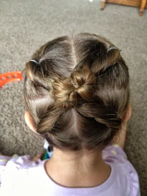 Cross bun hairstyle for little girls