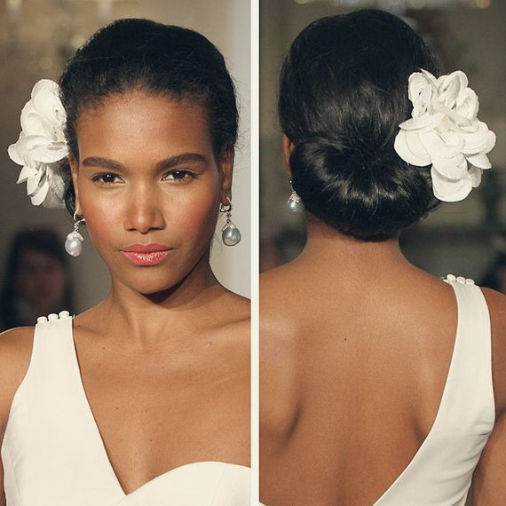Wedding updo hairstyle with flower for black women