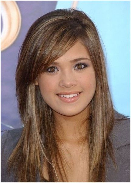 Long layered hairstyle with side-swept bangs