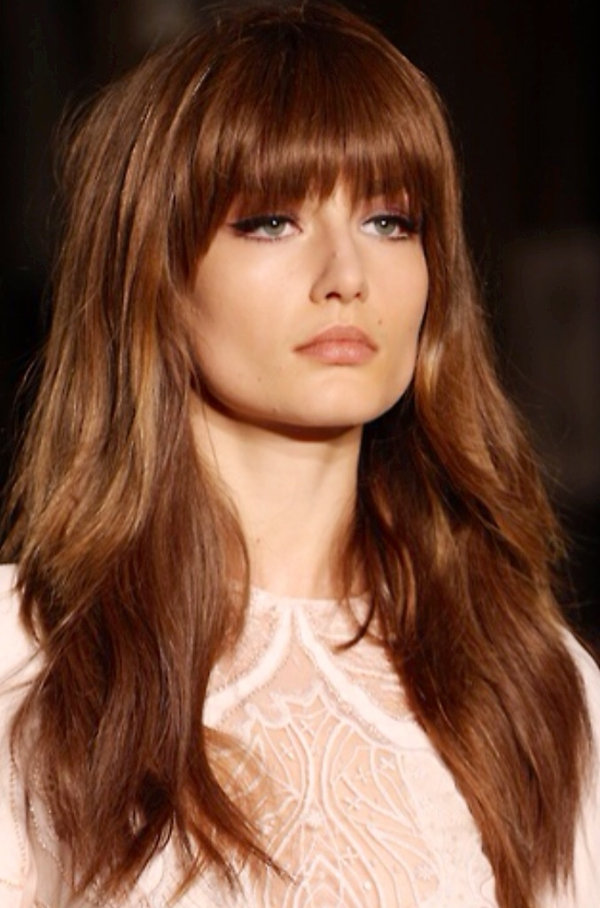 Long layered hairstyle with soft bangs