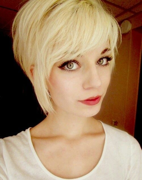 Blonde pixie with long bangs