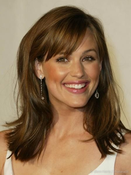 Medium hairstyle with bangs for brown hair